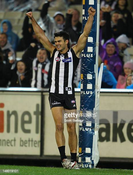 Chris Tarrant of the Magpies celebrates after kicking a goal during the AFL Round 16 game between the Geelong Cats and the Collingwood Magpies at the...