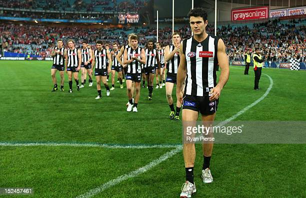 Chris Tarrant of the Magpies leads his team off the ground after the second AFL Preliminary Final match between the Sydney Swans and the Collingwood...
