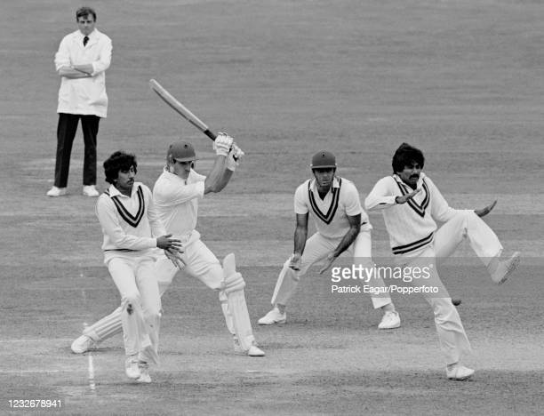 Chris Tavaré of England drives the ball past Pakistan fielder Javed Miandad during his innings of 82 runs in the 2nd Test match between England and...