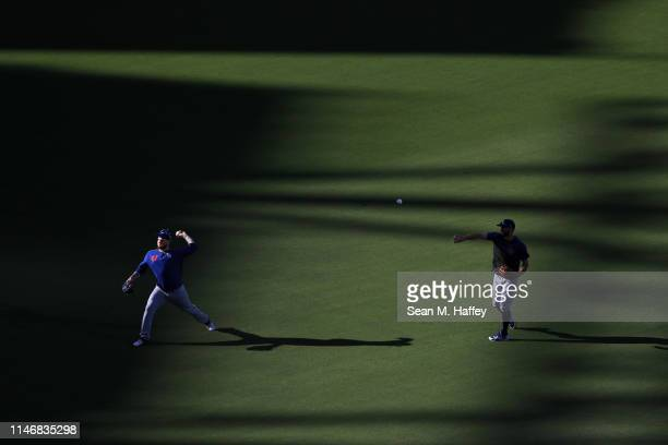 Chris Taylor and Alex Verdugo of the Los Angeles Dodgers warm up prior to a game against the San Diego Padres at PETCO Park on May 03 2019 in San...