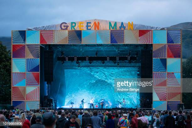 Chris Taylor, Edward Droste, Daniel Rossen and Christopher Bear of Grizzly Bear perform on the Mountain stage during day 3 at Greenman Festival on...