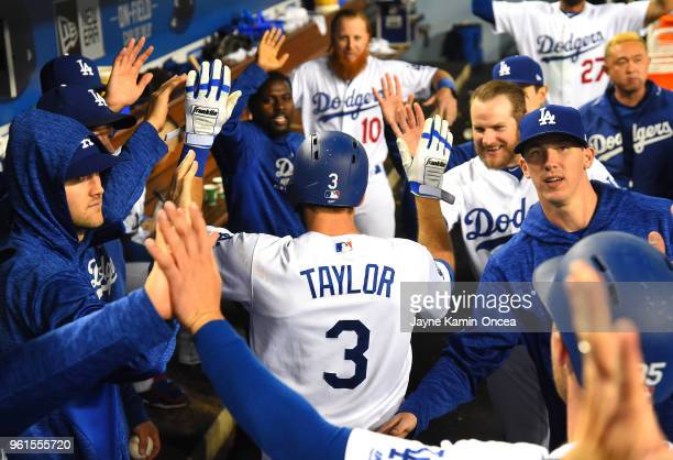 Chris Taylor is greeted in the dugout after a two run home run scoring Cody Bellinger of the Los Angeles Dodgers in the sixth inning of the game...