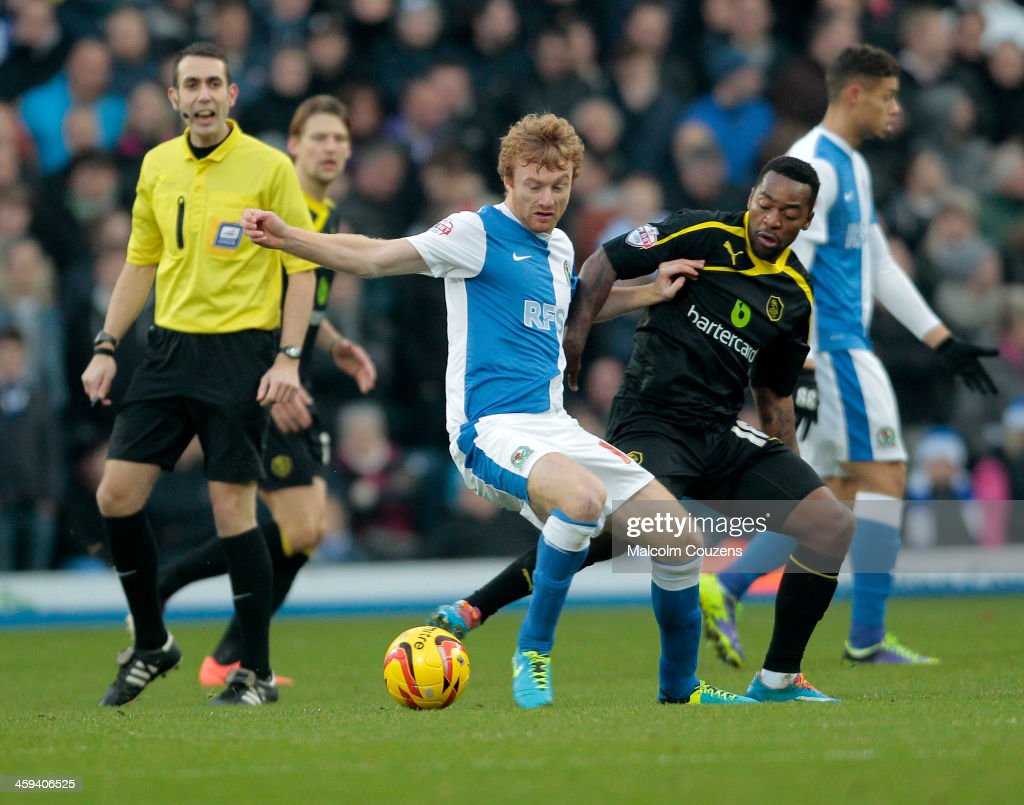 Chris Taylor of Blackburn Rovers (L) competes with Jacques Maghoma of Sheffield Wednesday during the Sky Bet Championship match between Blackburn Rovers and Sheffield Wednesday at Ewood Park on December 26, 2013 in Blackburn, England.