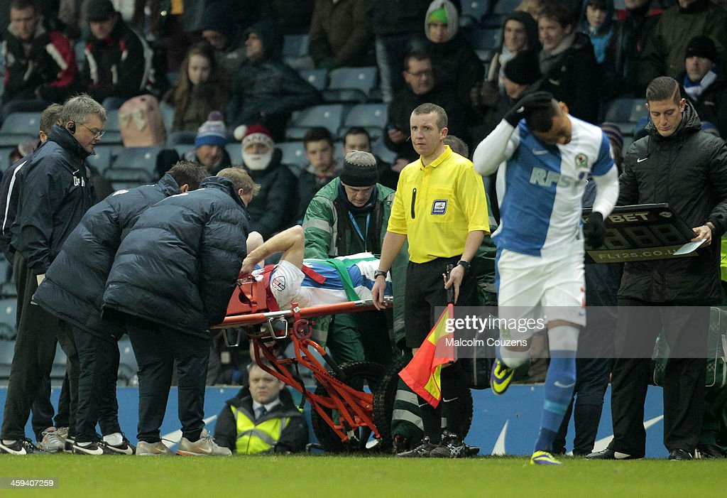 Chris Taylor of Blackburn Rovers is taken from the field of play on a stretcher during the Sky Bet Championship match between Blackburn Rovers and Sheffield Wednesday at Ewood Park on December 26, 2013 in Blackburn, England.