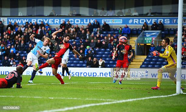 Chris Taylor of Blackburn Rovers scores their first and equalising goal past goalkeeper Lukasz Fabianski of Swansea City during the FA Cup Fourth...