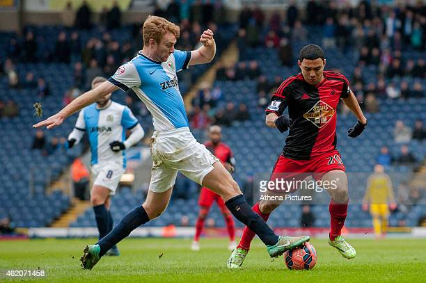 Chris Taylor of Blackburn Rovers takes the ball from underneath Jefferson Montero of Swansea City during the FA Cup Fourth Round match between...