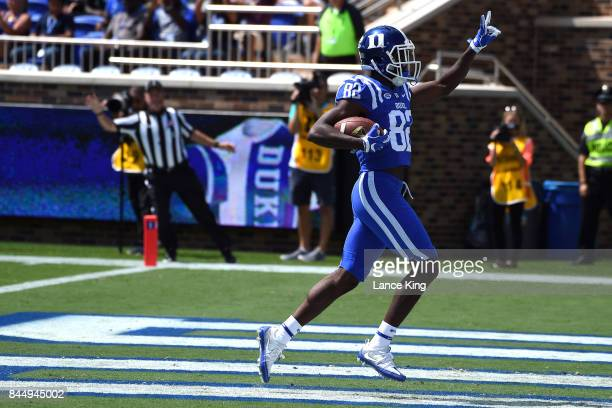 Chris Taylor of the Duke Blue Devils reacts following a touchdown reception against the Northwestern Wildcats at Wallace Wade Stadium on September 9...
