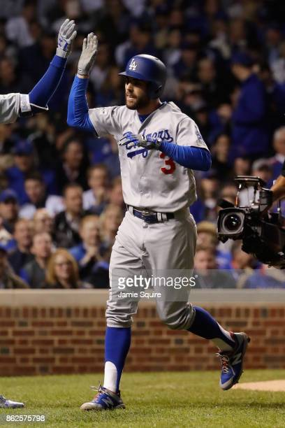 Chris Taylor of the Los Angeles Dodgers celebrates after hitting a home run in the third inning against the Chicago Cubs during game three of the...