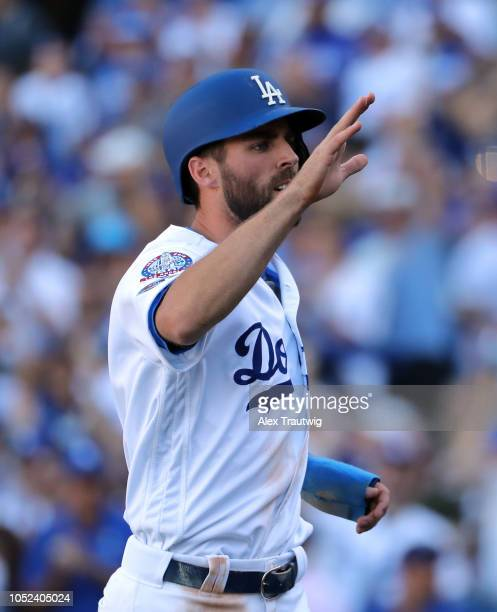 Chris Taylor of the Los Angeles Dodgers celebrates after scoring in the fifth inning of Game 5 of the NLCS against the Milwaukee Brewers at Dodger...