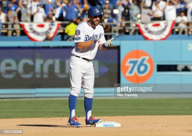Chris Taylor of the Los Angeles Dodgers celebrates from second base after advancing on a throwing error in the fifth inning of Game 5 of the NLCS...