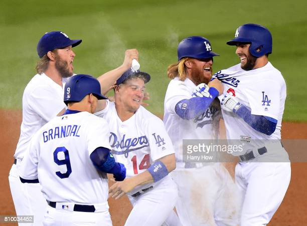 Chris Taylor of the Los Angeles Dodgers celebrates his game winning hit with Justin Turner Enrique Hernandez Clayton Kershaw and Yasmani Grandal for...