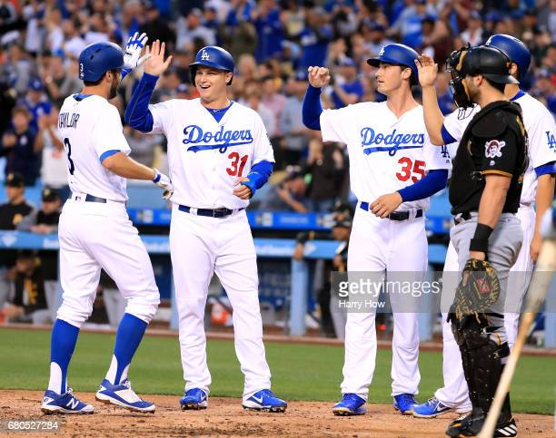 Chris Taylor of the Los Angeles Dodgers celebrates his grand slam homerun to take a 50 lead with Joc Pederson Cody Bellinger and Corey Seager as...