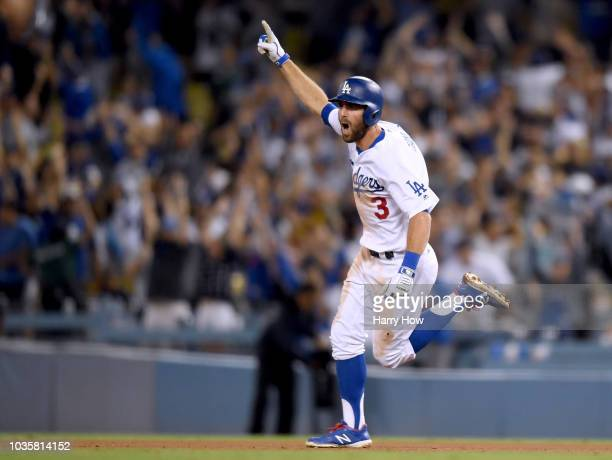 Chris Taylor of the Los Angeles Dodgers celebrates his solo homerun to win the game 32 over the Colorado Rockies during the 10th inning at Dodger...