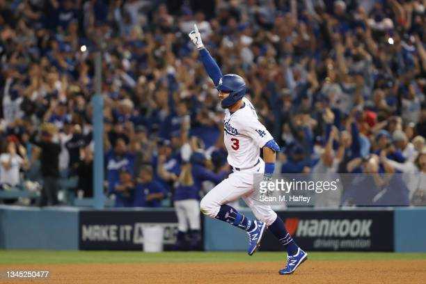 Chris Taylor of the Los Angeles Dodgers celebrates his walk off two-run home run in the ninth inning to defeat the St. Louis Cardinals 3 to 1 during...