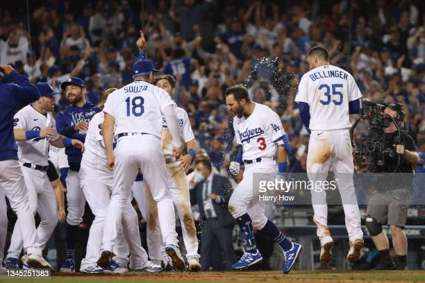Chris Taylor of the Los Angeles Dodgers celebrates with teammates after his walk off two-run home run in the ninth inning to defeat the St. Louis...