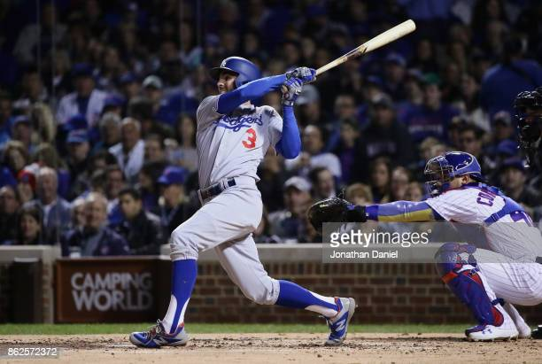 Chris Taylor of the Los Angeles Dodgers hits a home run in the third inning against the Chicago Cubs during game three of the National League...