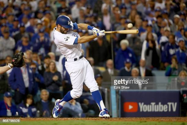 Chris Taylor of the Los Angeles Dodgers hits a RBI double to score Austin Barnes during the sixth inning against the Houston Astros in game six of...