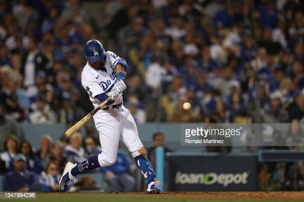 Chris Taylor of the Los Angeles Dodgers hits a solo home run during the seventh inning of Game Five of the National League Championship Series...