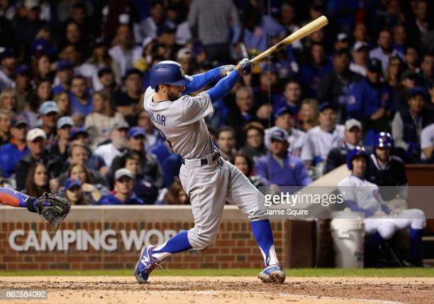 Chris Taylor of the Los Angeles Dodgers hits a triple in the fifth inning against the Chicago Cubs during game three of the National League...