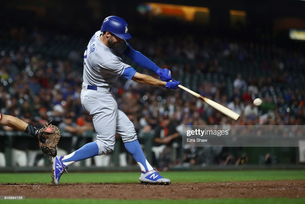 Chris Taylor #3 of the Los Angeles Dodgers hits an RBI single in the fourth inning against the San Francisco Giants at AT&T Park on September 11, 2017 in San Francisco, California.