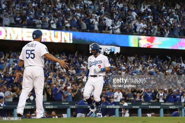 Chris Taylor of the Los Angeles Dodgers is congratulated by Albert Pujols following a two run home run during the second inning of Game Five of the...