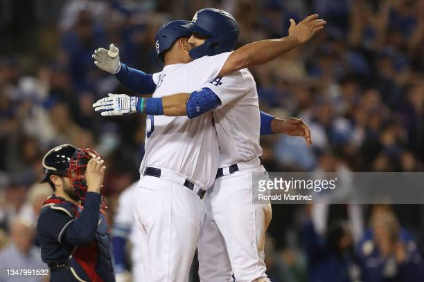 Chris Taylor of the Los Angeles Dodgers is congratulated by Albert Pujols following a two run home run during the fifth inning of Game Five of the...