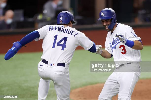 Chris Taylor of the Los Angeles Dodgers is congratulated by Enrique Hernandez after hitting a two run home run against the Tampa Bay Rays during the...