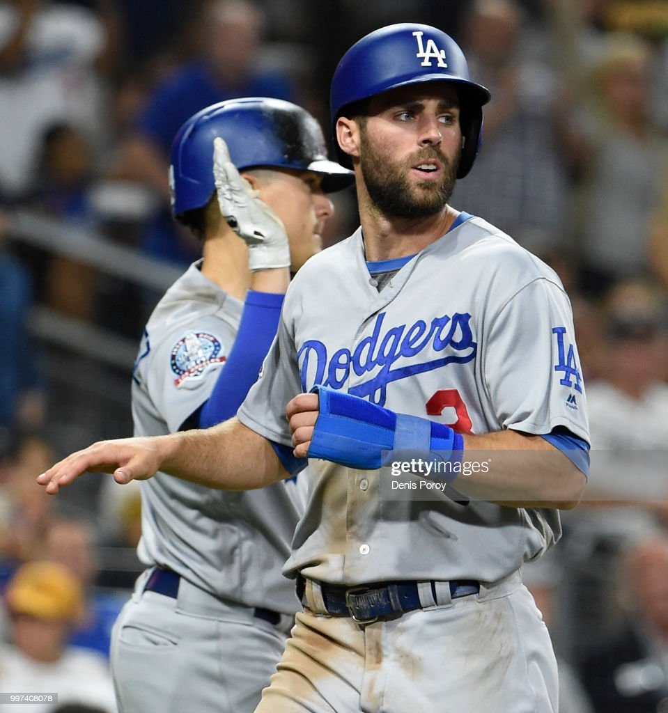 Chris Taylor #3 of the Los Angeles Dodgers is congratulated by Enrique Hernandez #14 of the Los Angeles Dodgers after scoring during the seventh inning of a baseball game against the San Diego Padres at PETCO Park on July 12, 2018 in San Diego, California.