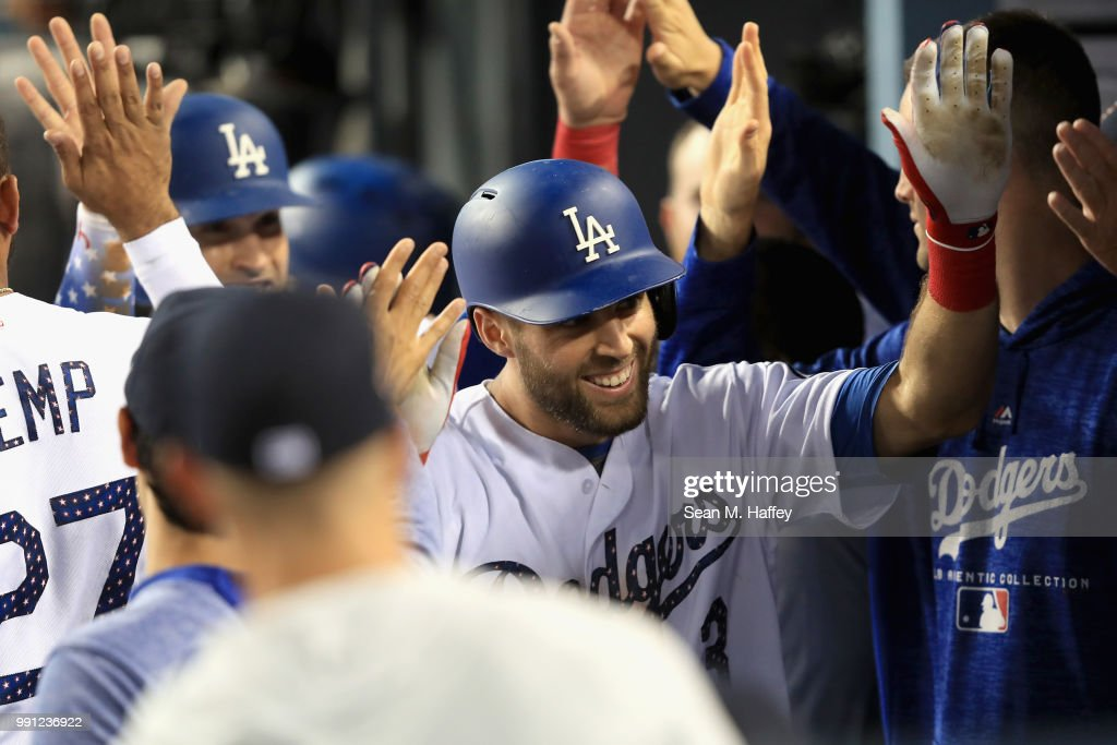 Chris Taylor #3 of the Los Angeles Dodgers is congratulated in the dugout after hitting a two run home run during the fourth inning of a game against the Pittsburgh Pirates at Dodger Stadium on July 3, 2018 in Los Angeles, California.