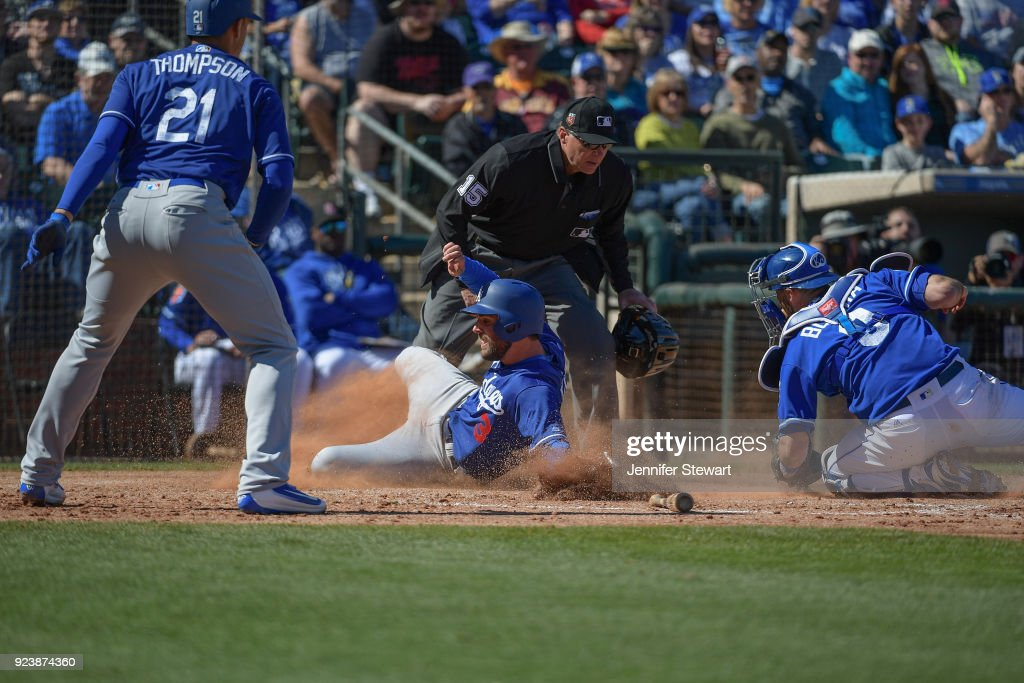 Chris Taylor #3 of the Los Angeles Dodgers is tagged out at home by Drew Butera #9 of the Kansas City Royals while attempting to advance on a play in the second inning at Surprise Stadium on February 24, 2018 in Surprise, Arizona.