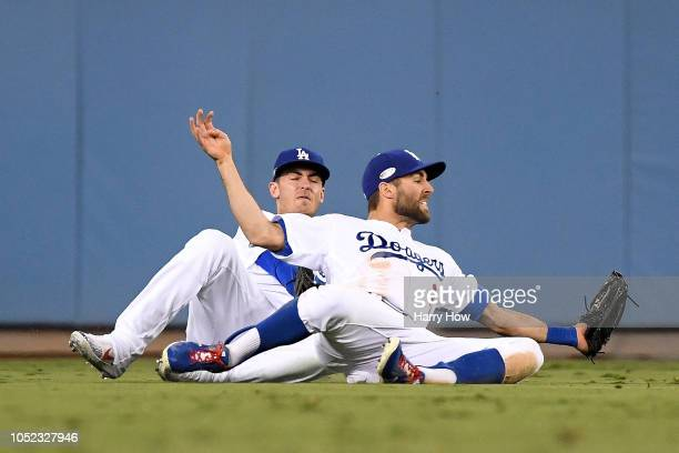 Chris Taylor of the Los Angeles Dodgers makes a diving catch against the Milwaukee Brewers during the seventh inning in Game Four of the National...