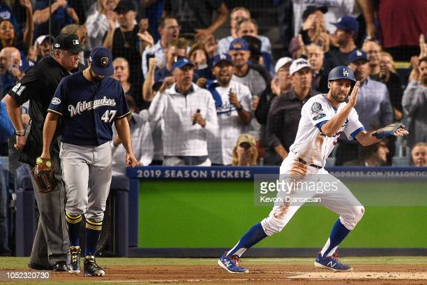Chris Taylor of the Los Angeles Dodgers reacts after scoring a run on a RBI single by Brian Dozier off Gio Gonzalez of the Milwaukee Brewers during...