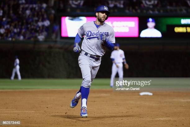 Chris Taylor of the Los Angeles Dodgers rounds the bases after hitting a home run in the third inning against the Chicago Cubs during game three of...