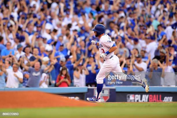 Chris Taylor of the Los Angeles Dodgers runs the bases after hitting a solo home run during the first inning against the Houston Astros in game one...