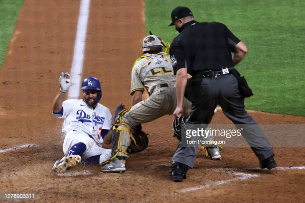 Chris Taylor of the Los Angeles Dodgers scores a run against the San Diego Padres during the third inning of Game One of the National League Division...