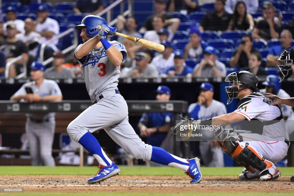 Chris Taylor #3 of the Los Angeles Dodgers singles in the sixth inning of the game against the Miami Marlins at Marlins Park on May 16, 2018 in Miami, Florida.