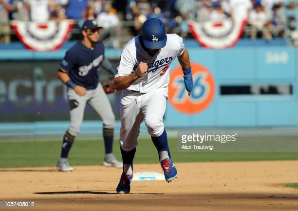 Chris Taylor of the Los Angeles Dodgers steals third base in the fifth inning of Game 5 of the NLCS against the Milwaukee Brewers at Dodger Stadium...