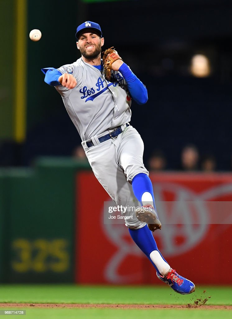 Chris Taylor #3 of the Los Angeles Dodgers throws over to first base during the sixth inning against the Pittsburgh Pirates at PNC Park on June 6, 2018 in Pittsburgh, Pennsylvania.