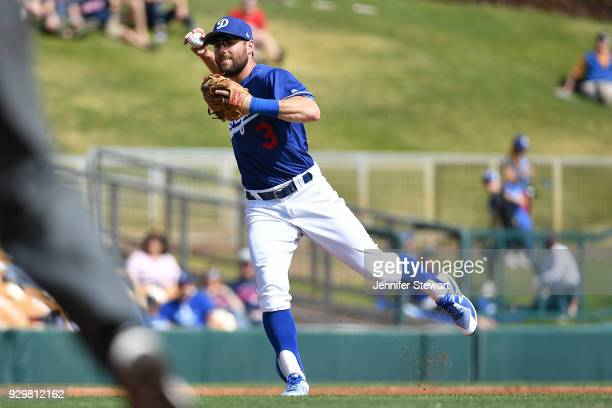 Chris Taylor of the Los Angeles Dodgers throws the ball to make the out against the Cleveland Indians in the spring training game at Camelback Ranch...