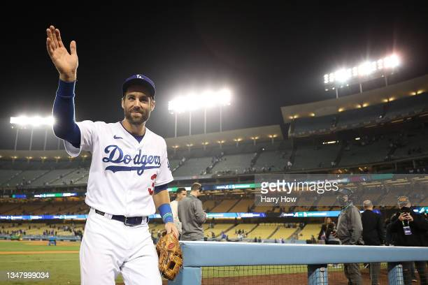 Chris Taylor of the Los Angeles Dodgers waves to fans following Game Five of the National League Championship Series against the Atlanta Braves at...
