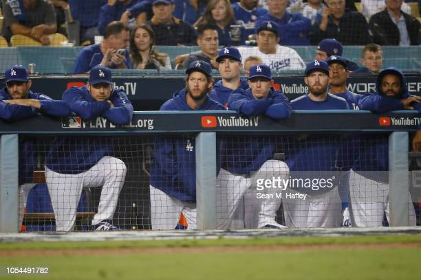 Chris Taylor Rich Hill Clayton Kershaw Ross Stripling Walker Buehler and their Los Angeles Dodgers teammates look on from the dugout in the ninth...