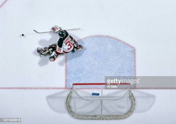 Chris Terreri, Goalkeeper for the New Jersey Devils reaches to make a save during the NHL Eastern Conference Atlantic Division game against the...
