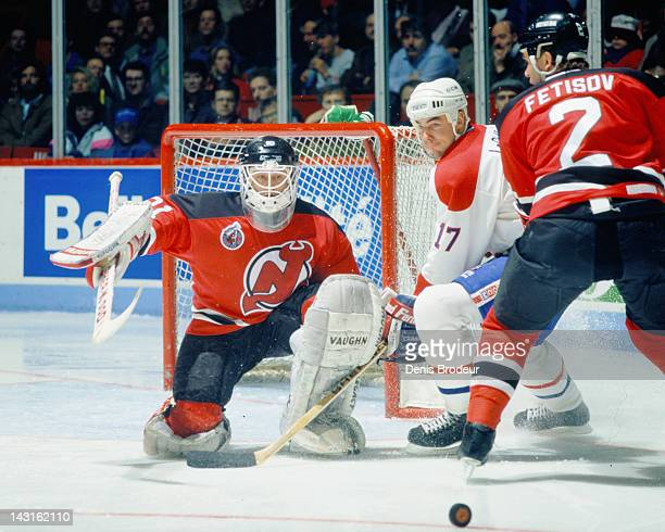 Chris Terreri of the New Jersey Devils makes a save on a shot from John LeClair of the Montreal Canadiens Circa 1992 at the Montreal Forum in...