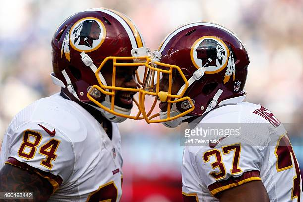 Chris Thompson of the Washington Redskins celebrates with Niles Paul after scoring a 9 yard touchdown in the second quarter against the New York...