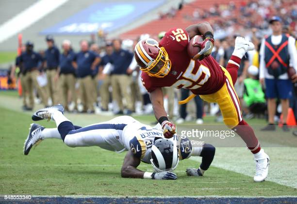 Chris Thompson of the Washington Redskins leaps for the pylon to score a touchdown over Maurice Alexander of the Los Angeles Rams during the second...