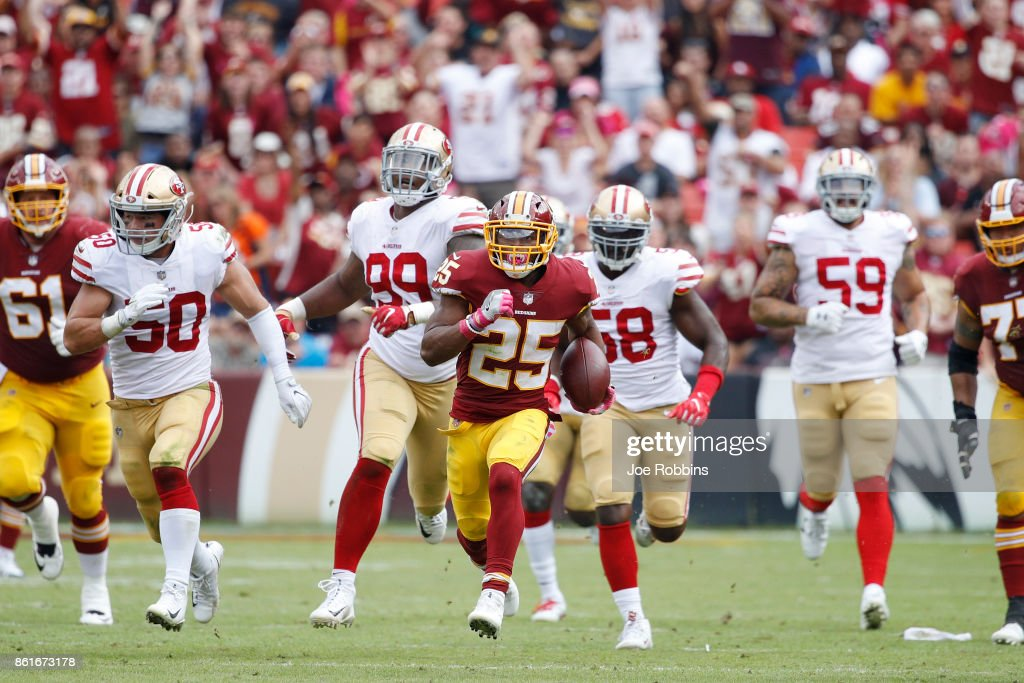 Chris Thompson #25 of the Washington Redskins runs for 49 yards after a catch to set up a field goal in the second quarter of a game against the San Francisco 49ers at FedEx Field on October 15, 2017 in Landover, Maryland.