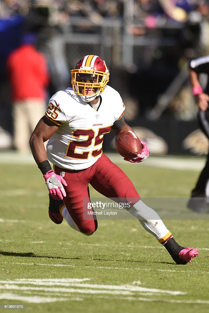 Chris Thompson #25 of the Washington Redskins runs with the ball in the fourth quarter during a football game against the Baltimore Ravens at M&T Bank Stadium on October 9, 2016 in Baltimore, Maryland.