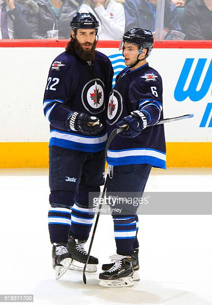 Chris Thorburn and Alexander Burmistrov of the Winnipeg Jets discuss strategy during a second period stoppage in play against the Los Angeles Kings...