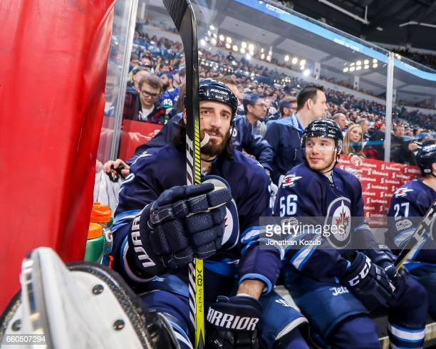 Chris Thorburn and Marko Dano of the Winnipeg Jets relax on the bench during a third period stoppage in play against the Vancouver Canucks at the MTS...