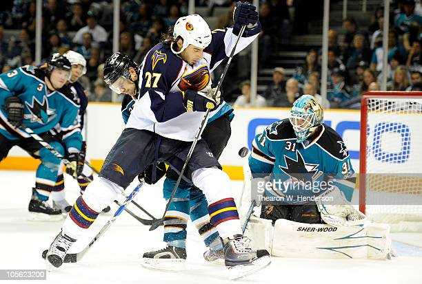 Chris Thorburn of the Atlanta Thrashers tries to shield the view of the puck from goalie Antti Niemi of the San Jose Sharks during an NHL Hockey game...